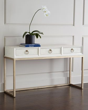 "Daisy Console at Horchow. Handcrafted of walnut veneers and radiatta solids. Top, sides, and drawer fronts wrapped in crocodile-embossed faux leather. Three drawers. 59""W x 19'D x 34""T."