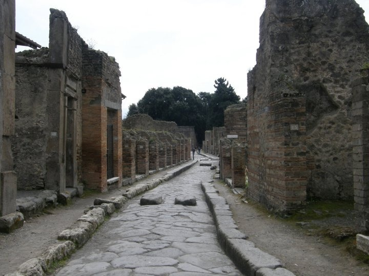 Pompeii (Italy) - The city of Pompeii is a partially buried Roman town-city near modern Naples in the Italian region of Campania, in the territory of the comune of Pompei. Along with Herculaneum, Pompeii was partially destroyed and buried under 4 to 6 m (13 to 20 ft) of ash and pumice in the eruption of Mount Vesuvius in AD 79, and it was lost for nearly 1700 years before its accidental rediscovery in 1749.