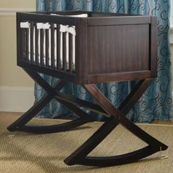 Keep your newborn nearby with this state of the art cradle. Made with solid workmanship, a rich espresso finish, and traditional styling, this cradle is a perfect piece of furniture and will complement any room including your master bedroom.