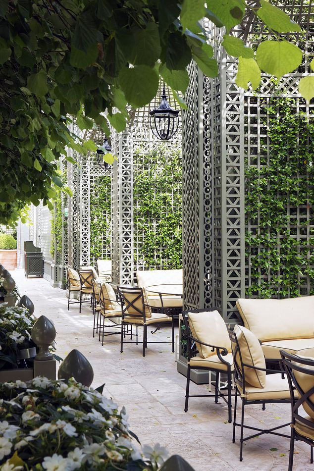 Architect Theirry Despont modeled the new Ritz garden on the Palais Royal. It features square-cut linden trees, central fountain and trellised seating alcoves.