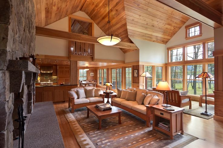 Craftsman great room with stone fireplace loft laminate for Great room flooring ideas
