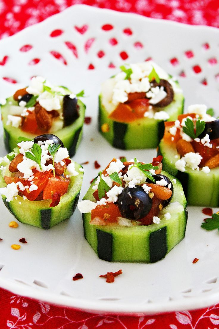 Mediterranean Cucumber Cups | cucumbers + red onion + red bell pepper + vine ripe tomato + black olives + dried oregano + feta + parsley + lemon + EVOO + salt + ground black pepper | Recipe from The Three Little Piglets