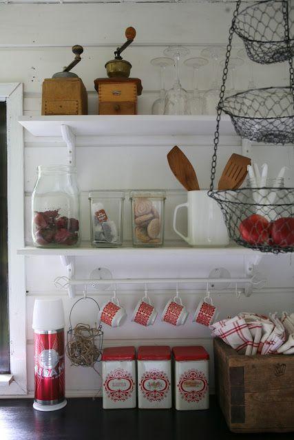 Finnish red and white rustic kitchen. Arabia Tytti, Airam, perunakappa, kahvimylly, kahvipurkit...