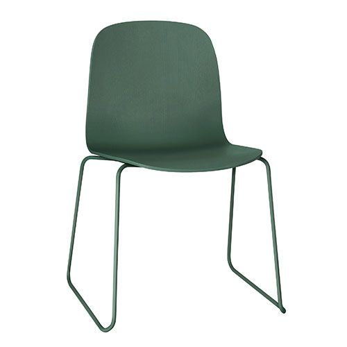The Muuto Visu Chair with a sled base in lovely deep green.