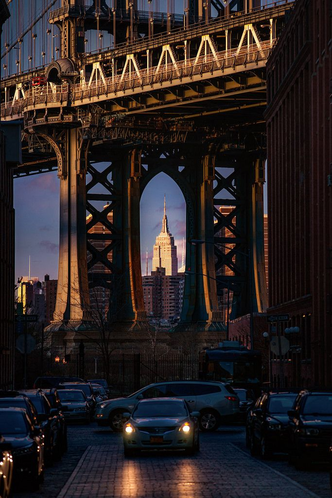NYC. Manhattan Brigde and ESB in the background in the evening