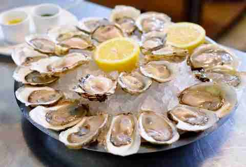 raw oysters with lemon at John Dory Oyster Bar