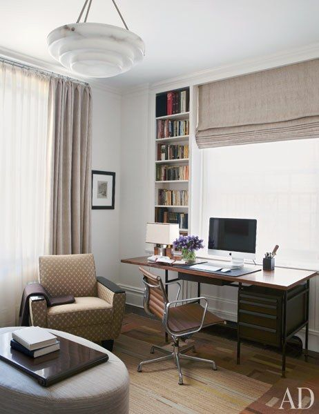 Arrayed in Fox's study are a '50s Wormley walnut-and-steel desk, an Eames desk chair from Design Within Reach, and an Art Deco club chair   archdigest.com