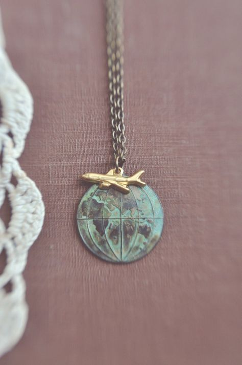 Globetrotter. a vintage travel inspired globe necklace