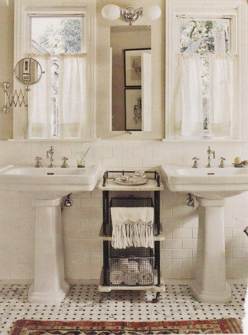 Great b+w floor, pedestal sinks, hanging medicine mirrors + great lights. Pedestal in guest + 1/2 bath but not master bath b/c it needs more storage than this - but looks cool.