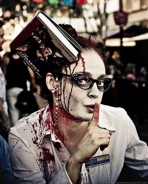 Librarian zombie- I know I'm always thinking I've found something clever that suits my Halloween needs, but I think this may have nailed it...in the head...with a book.