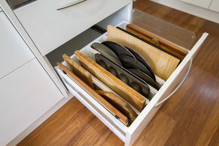 This kitchen is simple yet elegant, light and bright. Chopping board and baking tray storage. www.thekitchendesigncentre.com.au @thekitchen_designcentre