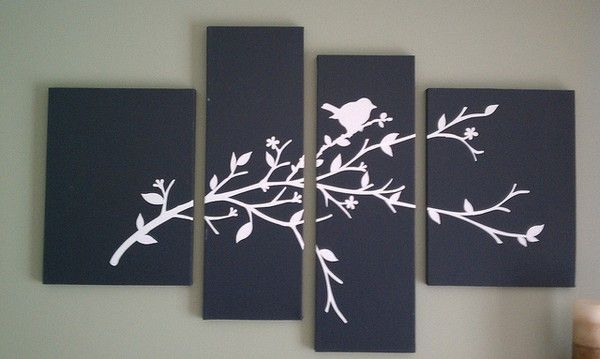 Take 4 canvases (2 of each size), paint them a solid base color and add vinyl or stenciled design. Very easy and cute