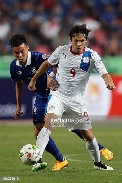 Misagh Medina of the Philippines holds off Charyl Yannic of Thailand during the 2014 AFF Suzuki Cup semi final 2nd leg match between Thailand and...