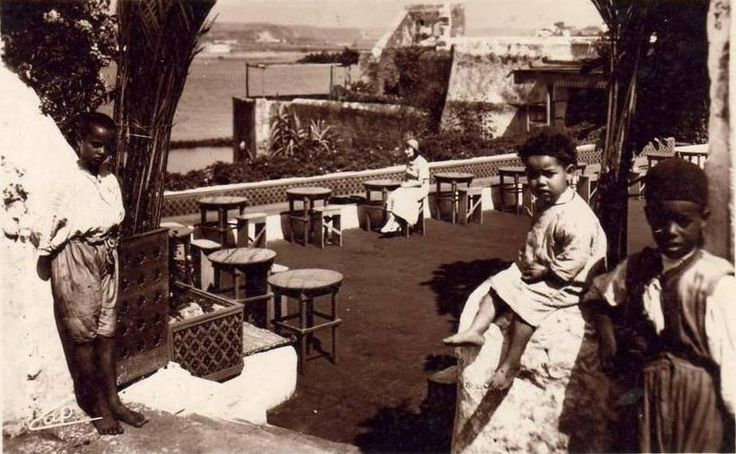 Children at the Café des Maures in the Oudayas qasbah in Rabat, circa 1935. The café still exists with the same sort of decoration, looking out over the Atlantic Ocean, the city of Salé and the mouth of the Bouregreg River (just visible in the photo).