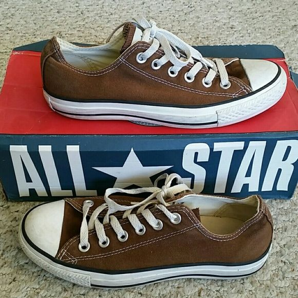 Classic Brown Converse All Star Low Top Shoes Classic Brown Chuck Taylor Converse All Star Low Top Shoes. Marked as a Converse or men's size 5, and women's size 7 on tag (soles say 5).  Used condition showing light normal wear and dirt. Mainly at heel logo and white toes. Overall have tons of life left! I have the box but it's kind of crushed. Converse Shoes Sneakers