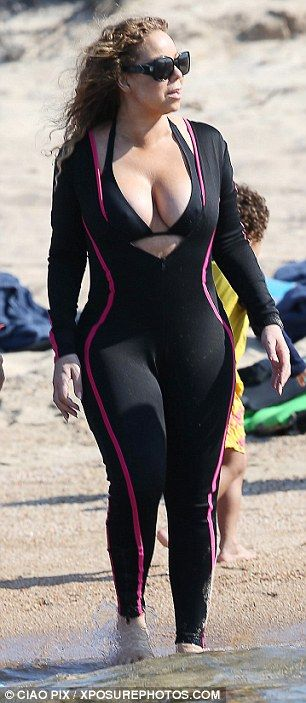 Family fun: Mariah hit the beach with her daughter Monroe, showing off her figure in her halter neck bikini