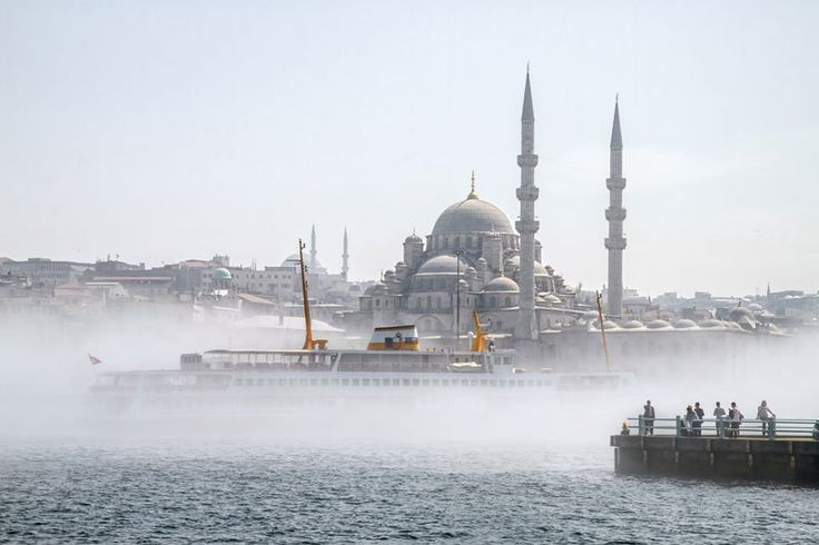 In this beautiful capture by Jürgen Horn and Michael Powell @ for91days.com, we see mist on the Golden Horn of Istanbul. The Golden Horn is an inlet of the Bosphorus dividing the city of Istanbul and forming the natural harbor that has sheltered Greek, Roman, Byzantine, Ottoman and other ships for thousands of years.