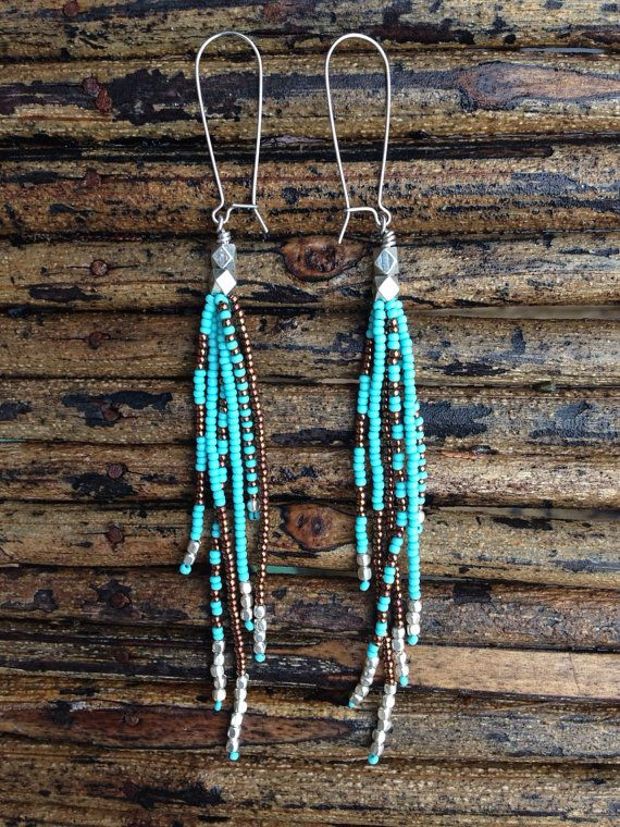 Long Turquoise earrings known as Shoulder Dusters measuring 5 1/4 inches from the top of the earring hook all the way to the bottom. Very