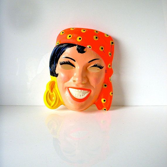 I had this exact mask as a child and wore it with a fancy red dress of my mother's.  Good times.