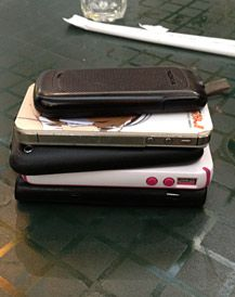 Phone Stack: It works like this: As you arrive at dinner, each person places their phone face down in the center of the table. As dinner progresses, you'll hear various texts and emails arriving. You will do ABSOLUTELY NOTHING. You are bound by the single, all-important rule of the phone stack: Whoever picks up their phone foots the entire lunch/dinner bill. It's about time people learned phone etiquette!