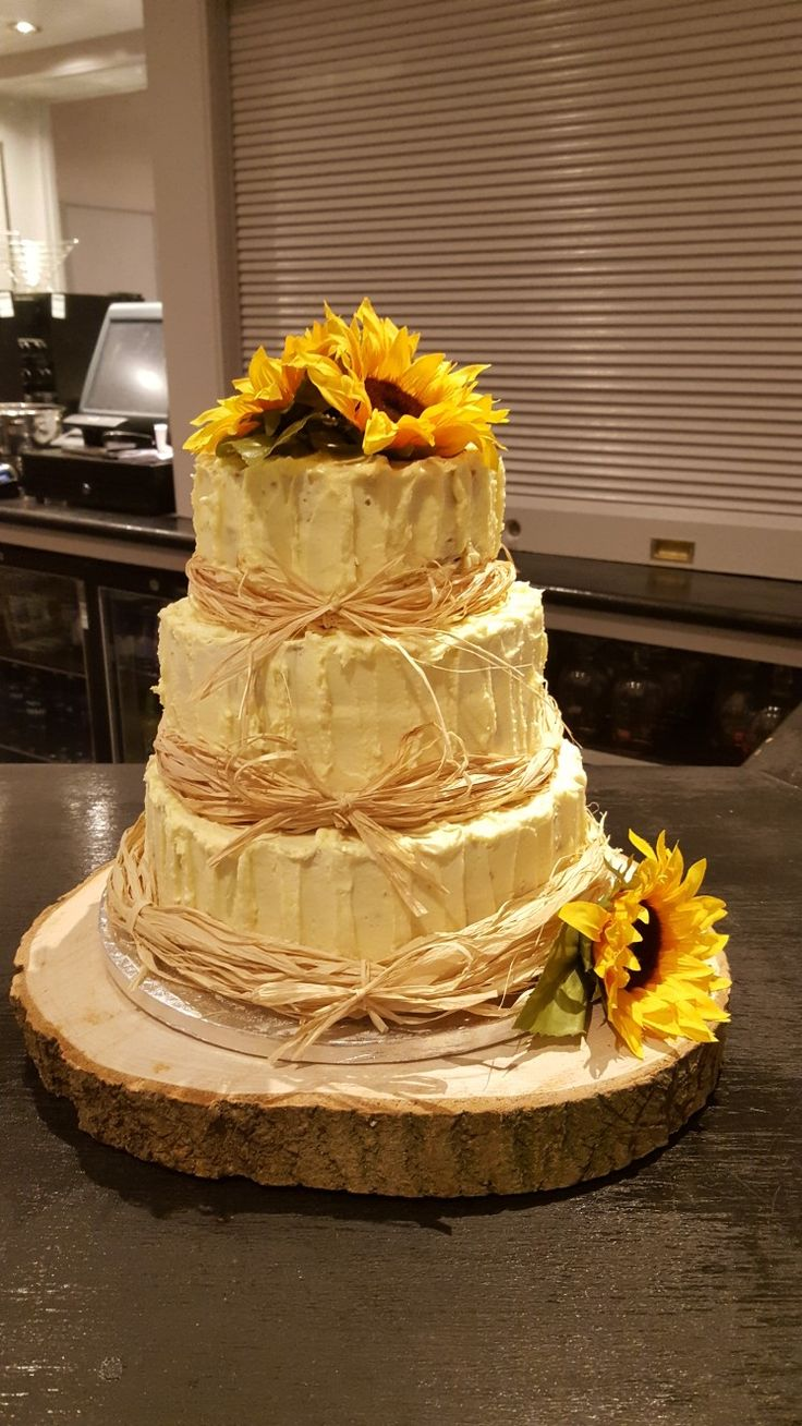 3 tier vintage wedding cake #buttericing #raffia #bows #sunflowers