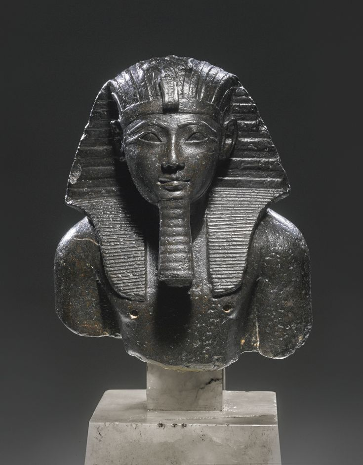 An Egyptian Basalt Bust of Tuthmosis III, 18th Dynasty, reign of Tuthmosis III, 1479-1426 B.C. | lot | Sotheby's: