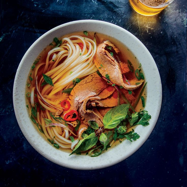 Mrs. Tran's Master Pho Broth with Flank Steak | Chef Qui Tran sticks to his mother's recipe with Mrs. Tran's Master Pho Broth with Flank Steak, the foundation for any great Vietnamese noodle soup. Get the recipe at Food & Wine.