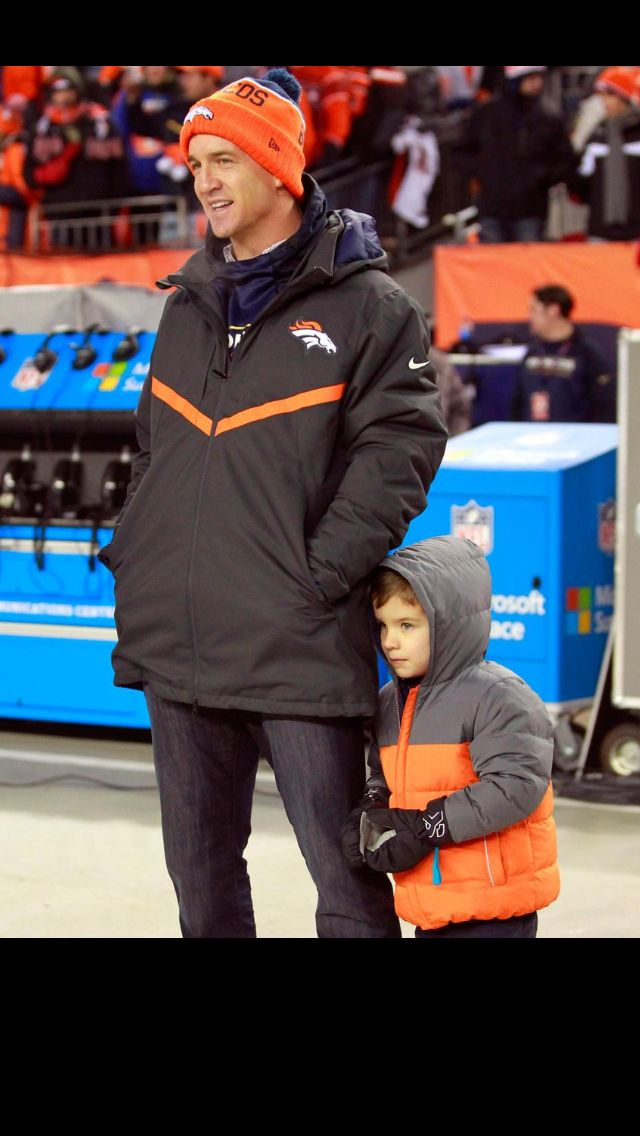 Peyton with son, Marshall on sidelines. Broncos vs Bengals