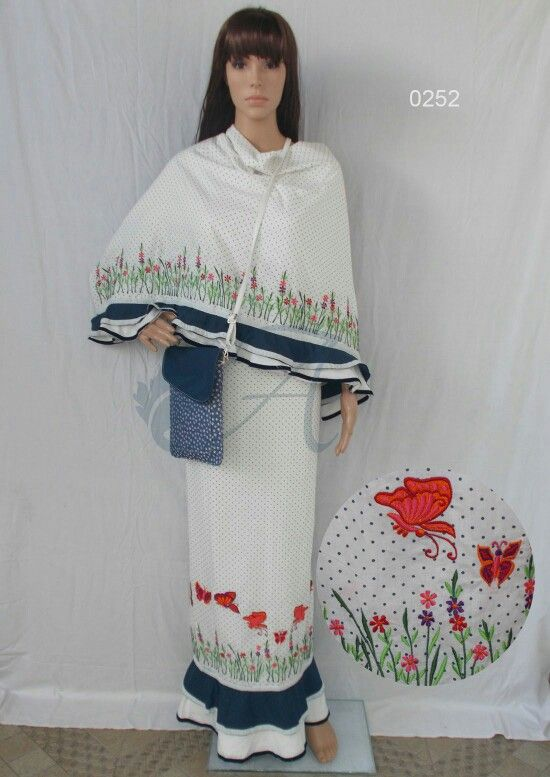 Soft offwhite cotton with polka dot print emblished with butterfly design machine embroidery and double layered frills.
