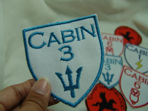Calling all Half-bloods!!! Show which cabin you belong to. My ready-made inventory has a white background and one of three designs: * Cabin 1 (Zeus) – Lightning bolt is yellow; font is royal blue * Cabin 3 (Poseidon) – Trident design and font are aquamarine * Cabin 5 (Ares) - Helmet