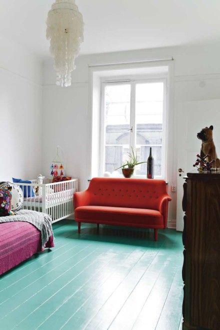 teal floor red sofa