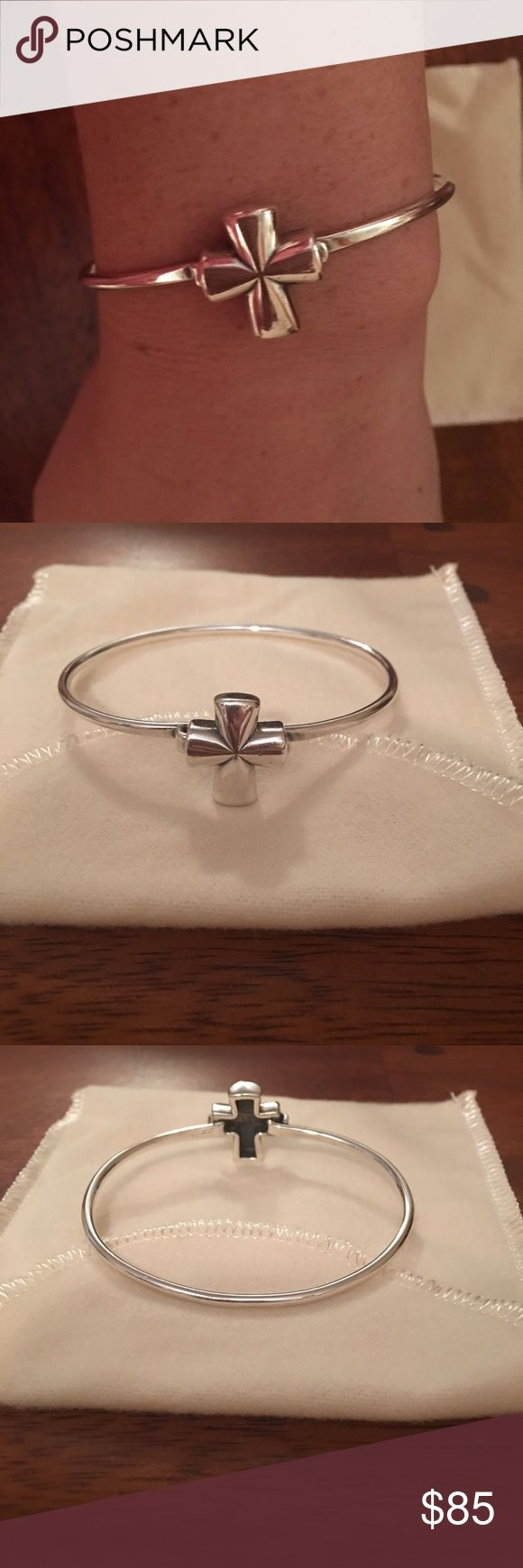 James Avery St. Teresa Cross Hook Bracelet James Avery St. Teresa Cross Hook Bracelet. Design is retired. Previously loved. Minimal signs of wear. Just cleaned at store & has dust bag. This is an elegant and charming James Avery St. Teresa Cross bangle bracelet, it is crafted from solid sterling silver in a fine polished finish and fastens with a hook clasp. The front has a Cross attached at one side of the bangle and opens from the other side.  Material: Sterling silver  Measurements: 6.75…