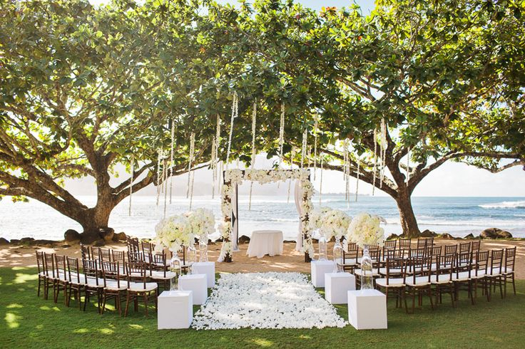Stunning St. Regis Princeville Resort Kauai wedding ceremony venue location. Elegant and ocean front ceremony at Kamani Cove.