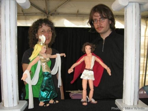 "Peggy and Mike Artelle performing a scene from ""Heroes Past and Present"" at the Puppets Up Festival in 2006. Peggy is performing Athena and Mike is performing Perseus."