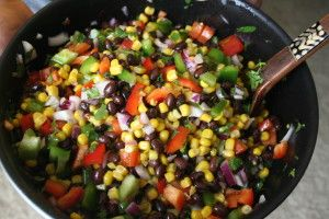 1 red bell pepper, diced  1 tin of black beans, drained and rinsed  1 tin of kernel corn, drained  1/3 cup diced red onion  1/4 cup chopped cilantro  (optional) 1 jalapeno pepper, seeded & minced   Dressing:  Whisk together:  1/4 c. olive oil  juice from 2 limes  1 tsp. cumin  salt and pepper