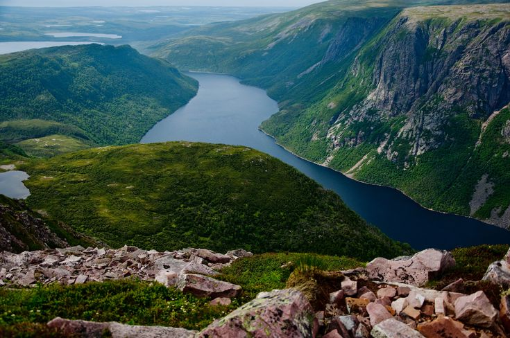 """Gros Morne National Park is a world heritage site located on the west coast of Newfoundland. At 1,805 km2 (697 sq mi), it is the second largest national park in Atlantic Canada (surpassed by Torngat Mountains National Park at 9,700 km2 (3,700 sq mi). The park takes its name from Newfoundland's second-highest mountain peak (at 2,644 ft/806 m) located within the park. Its French meaning is """"large mountain standing alone,"""" or more literally """"great sombre."""" Gros Morn..."""