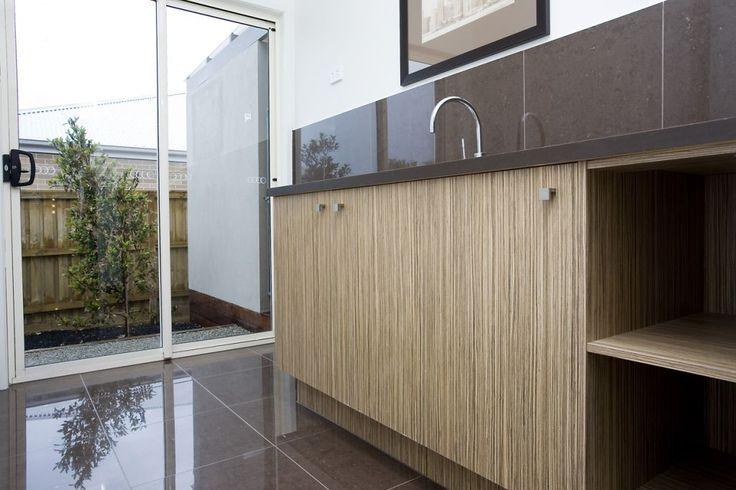 Laundry Tiles - STRATOS MOCCA POLISHED (600X600) MAXFL7091 Info: Splashback Tiles Grout: Light Grey