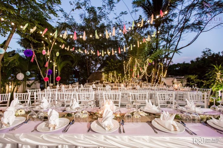 Reception decorated with simple lightbulb lighting, multicoloured streamers