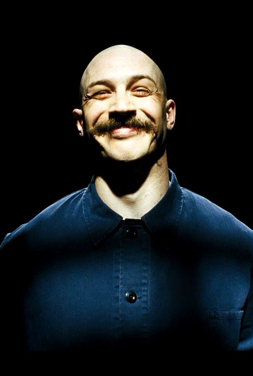 Tom Hardy in Bronson Interludes during Bronson's narration. Cutaways to this well-lit room where he responds to his own story with snarky facial expressions