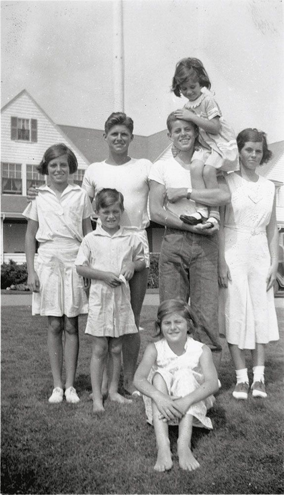 Eunice, Bobby, Joe Jr., Jack holding Jean, Rosemary and Pat (sitting) in Hyannis Port, circa 1933.