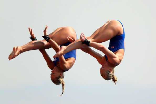 Tonia Couch and Sarah Barrow of Great Britain compete in the Women's 10m Platform Synchronised Diving preliminary round on day three of the 15th FINA World Championships at Piscina Municipal de Montjuic on July 22, 2013 in Barcelona, Spain.