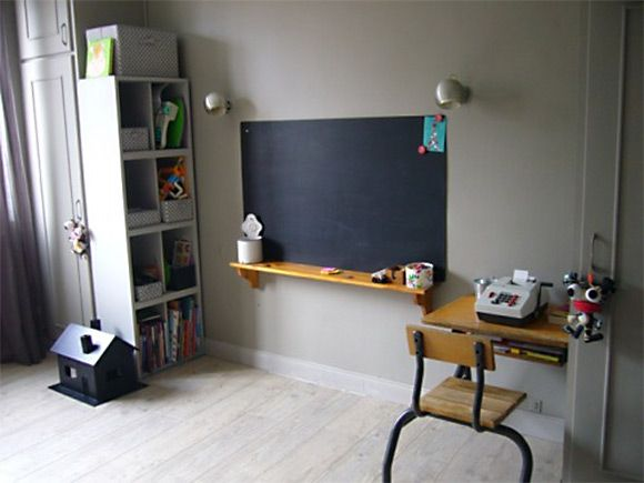 an old-time school desk and a chalkboard - we would have loved this as kids!
