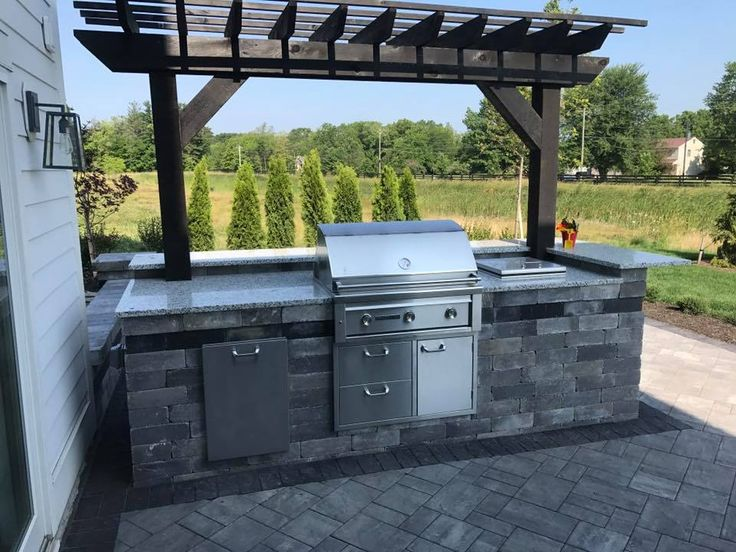 Natural grove Landscape & Patio LLC created this unique Cambridge Outdoor Kitchen. Cambridge Outdoor Kitchen Kits can be customized in the configuration that is perfect for you. Take a look today!