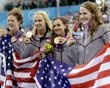 United States' 4 x 100-meter medley relay team from left, Allison Schmitt, Dana Vollmer, Rebecca Soni and Missy Franklin pose with their gold medals at the Aquatics Centre in the Olympic Park duri