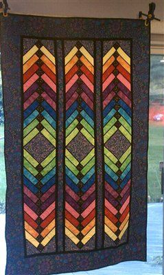 Beautiful stained glass quilt.