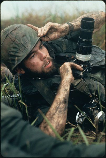 Pulitzer Prize winning photographer David Hume Kennerly under fire near Chon Thanh, South Vietnam, in 1972.: