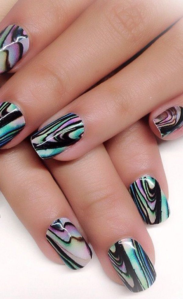 Awesome looking water marble nail art design in abstract pattern on top of a black base polish