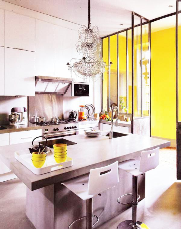 love yellow, and chandelier in a very mod/industrial-like space. fantastic mix of styles!