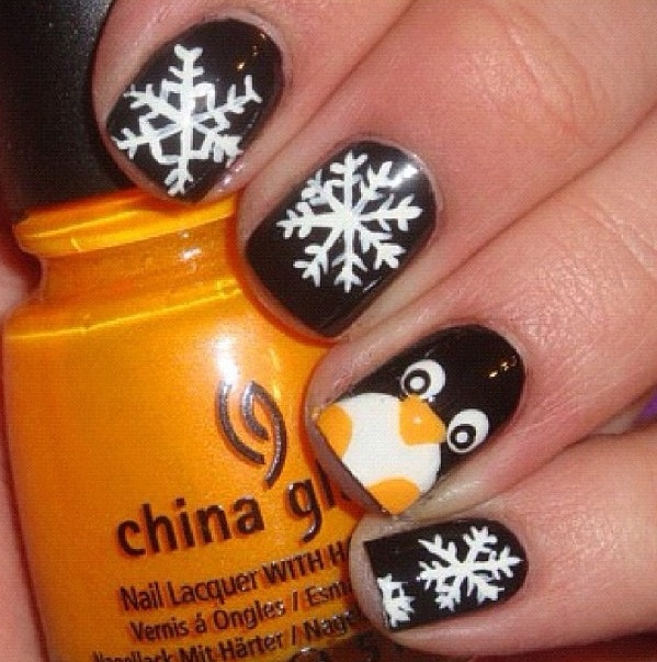 Snowflake and penguin nails-BUt w blue behind the snow flakes. Exactly what I want