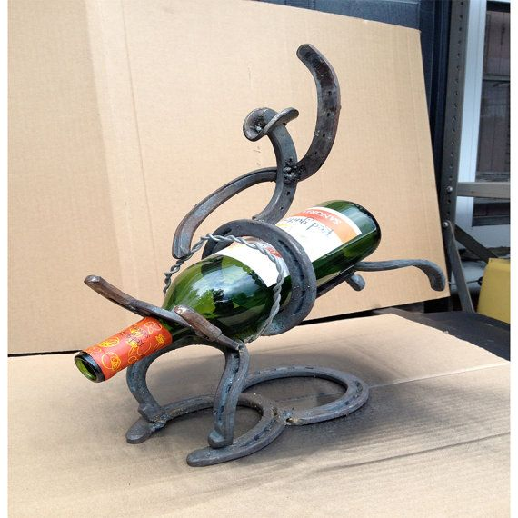 Made from steel horseshoes, Holds one Bottle of wine.